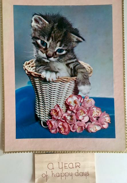 "vintage calendar with image of cat in basket - calendar front says "" A Year of happy days"""