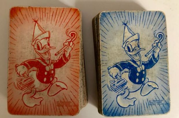 2 sets of cards - Donald Duck on back - one set in red, the other blue