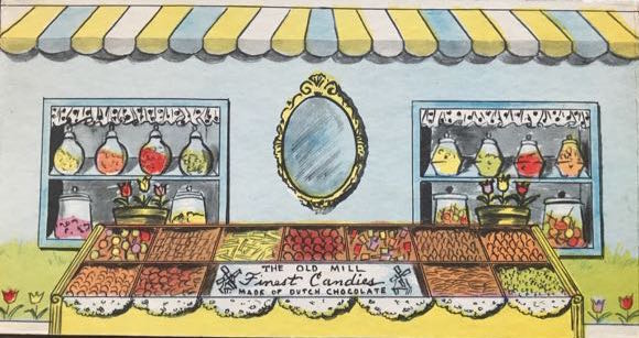 """illustration of display of chocolates and candy of fictional café """"the Old Mill""""."""