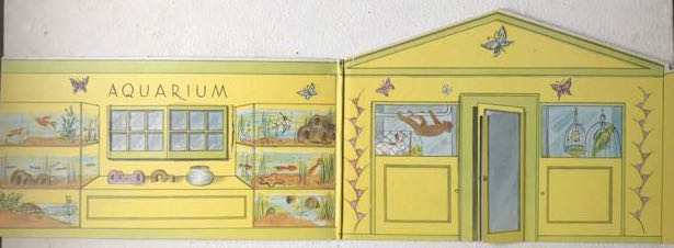 cardboard cut-out illustrated with interior of a Pet Shop (monkey, parrot and aquarium).