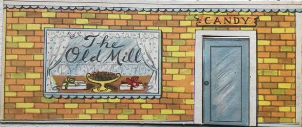 """cardboard cut-out of entrance to fictional café """"the Old Mill"""""""